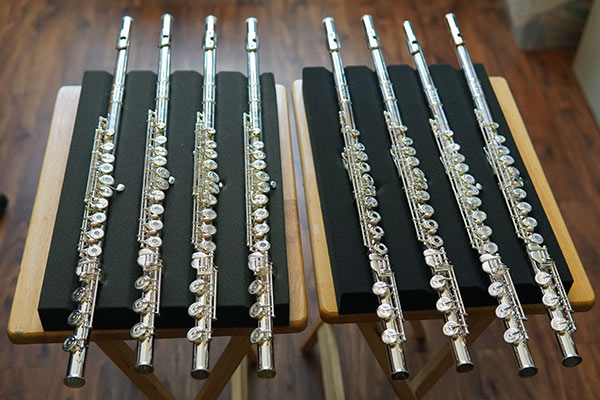 A selection of appropriate higher-level flutes presented to a student